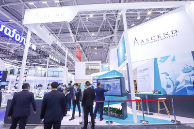 Visitors at Ascend Performance Materials' Chinaplas booth exploring the company's latest products via touchscreen.