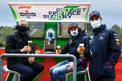 Heineken ambassador David Coulthard poses at the Heineken F1 Pit Wall Bar with Red Bull Racing Honda drivers Max Verstappen of the Netherlands and Sergio Perez of Mexico. (Photo by Mark Thompson/Getty Images for Heineken)