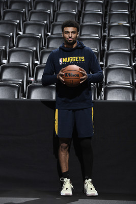 Wilson Advisory Staff member and Denver Nuggets point guard, Jamal Murray, holds the new official game ball of the NBA.